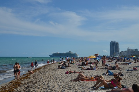 Cruise ship and crowds on the beach