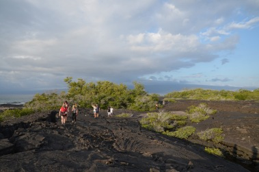 Group walking on the lava