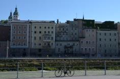 Bike. River. Buildings.