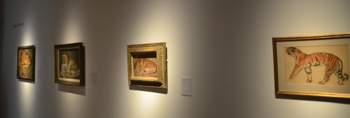 A wall of tiger artwork